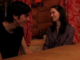 Brunette undresses and enjoys sex on a wooden table